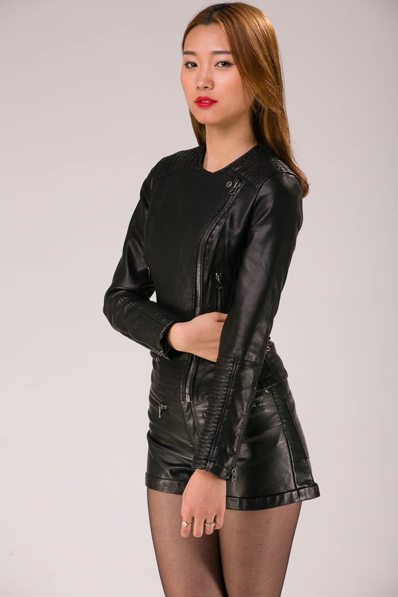 fashion-photography on white asian lady in leather outfit