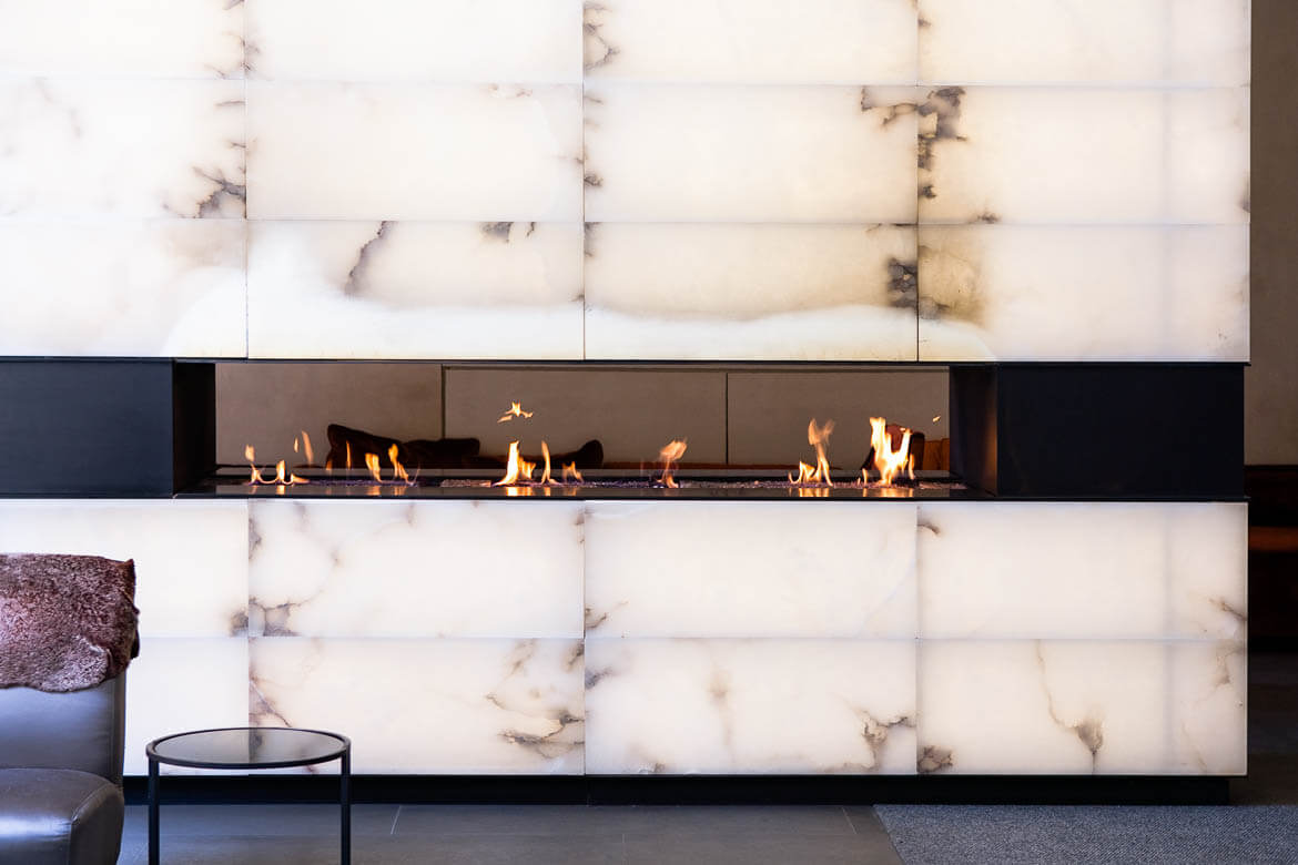 marble fire place in hotel lobby