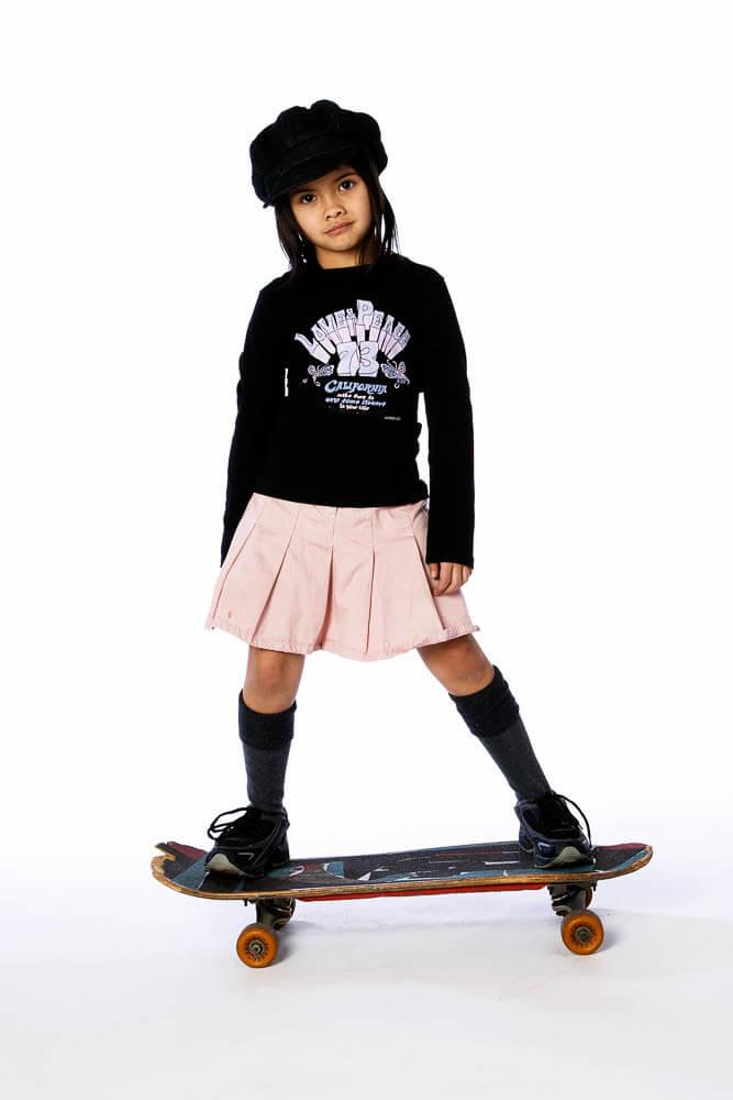 portrait asian girl skateboard