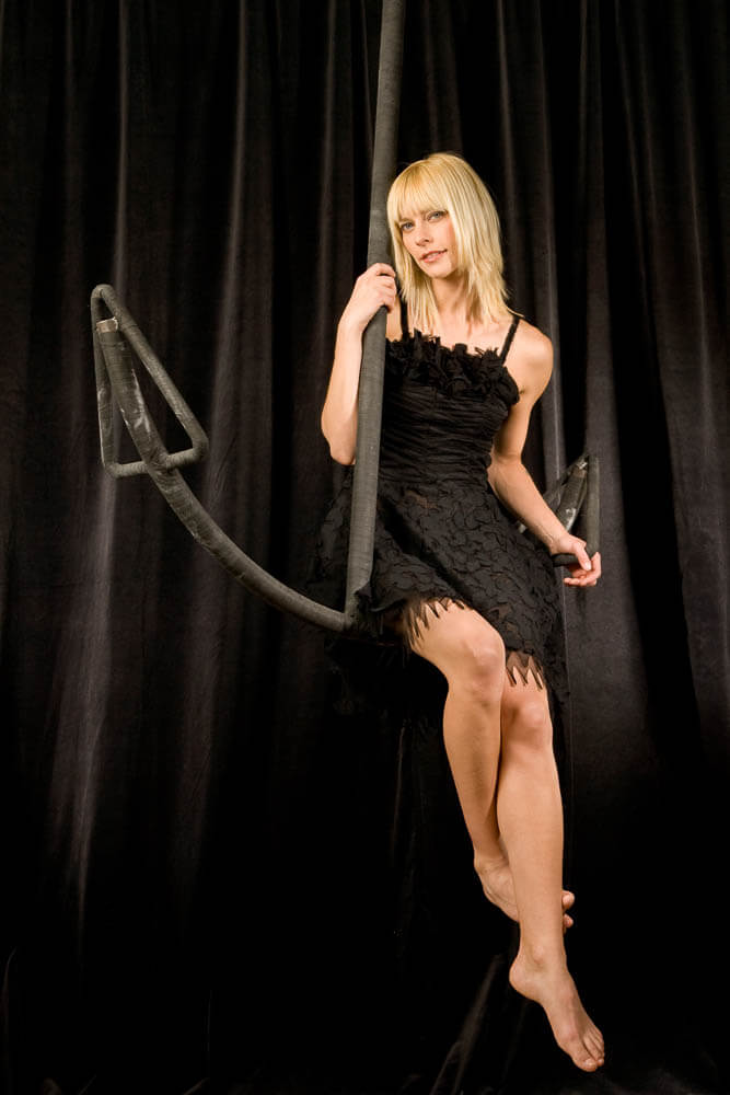 portrait of a blond woman on a giant anchor